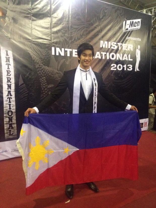 Gil holding Philippine flag..